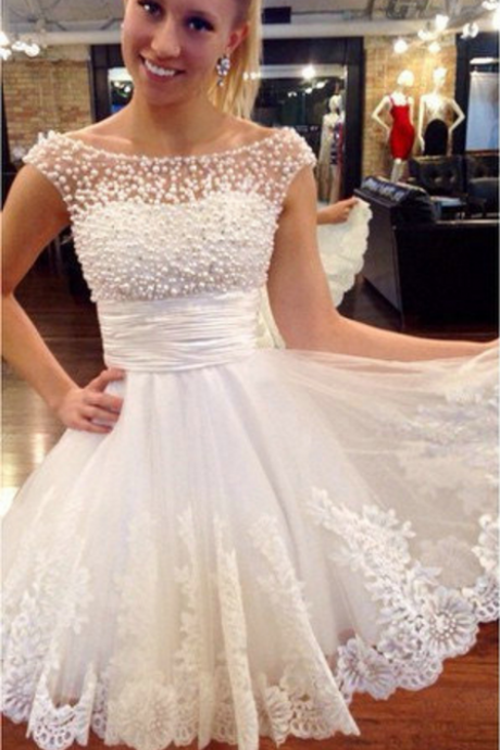 The white beaded, lovely homecoming gown, wedding dress, homecoming gown